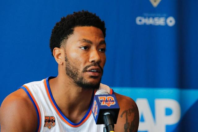 (FILES) This file photo taken on September 26, 2016 shows Derrick Rose during a press conference during the New York Knicks Media Day in White Plains, New YorkDerrick Rose, the youngest player to win the NBA Most Valuable Player award when he took the trophy in 2011, is talking over a one-year deal with the Cleveland Cavaliers, ESPN reported on July 20, 2017. The oft-injured 28-year-old point guard would add a backcourt spark for the Cavaliers as they try to mount a tougher challenge to Golden State, which beat Cleveland in two of their three NBA Finals matchups over the past three seasons. (AFP Photo/EDUARDO MUNOZ ALVAREZ)