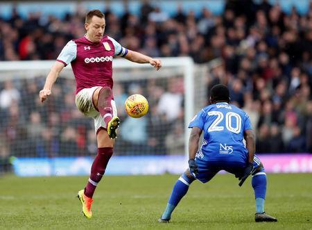 Soccer Football - Championship - Aston Villa vs Birmingham City - VIlla Park, Birmingham, Britain - February 11, 2018 Aston Villa's John Terry in action with Birmingham's Jermie Boga Action Images/Andrew Boyers