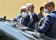 Algerian President Abdelmadjid Tebboune waves after casting his vote at a polling station on the western outskirts of capital