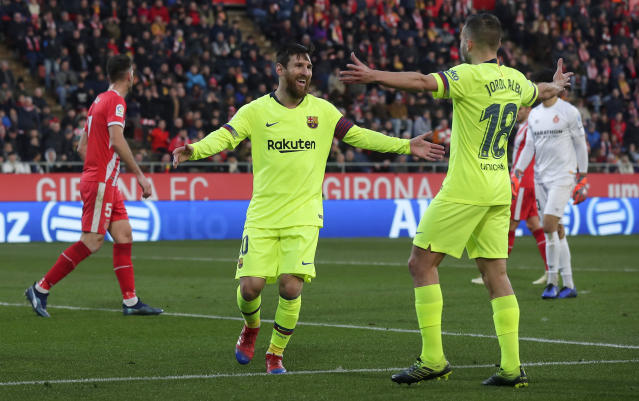 FC Barcelona's Lionel Messi celebrates after scoring his side's second goal during the Spanish La Liga soccer match between Girona and FC Barcelona at the Montilivi stadium in Girona, Spain, Sunday, Jan. 27, 2019. (AP Photo/Manu Fernandez)