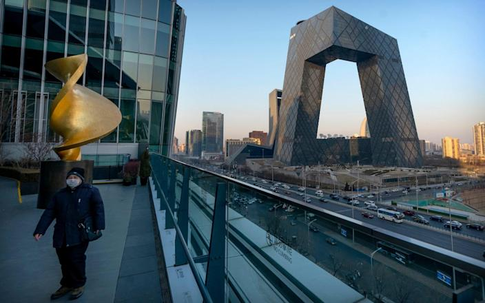 The CCTV headquarters in Beijing, the home of China's state-run TV network - AP