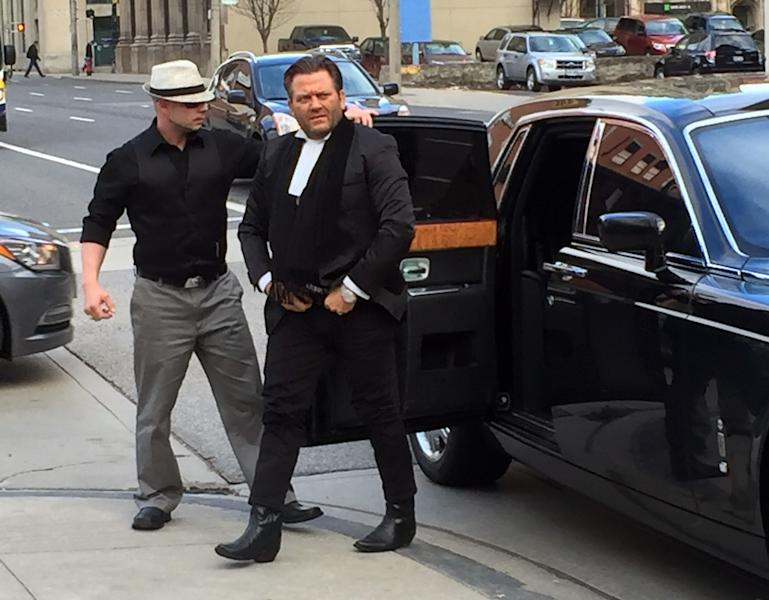 """Amedeo Dicarlo, lawyer for Karim Baratov, arrives at the courthouse in a chauffeured Rolls Royce in Hamilton, Ontario, Canada, on Wednesday, April 5, 2017. Baratov, accused in a massive hack of Yahoo emails said Wednesday he'll live with his parents and forgo access to phones and any electronic equipment if he's allowed out on bail. Officials allege that Baratov poses an """"extremely high flight risk'' because of his alleged ties to Russian agents. (AP Photo/Robert Gillies)"""