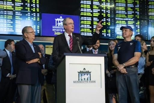 """""""This is a huge step forward for gaming, for the tracks, for the economy of the state,"""" said New Jersey's Democratic governor Phil Murphy, who visited Monmouth Park and placed the first two bets, including one on Germany winning the World Cup"""