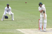 Australia's Steve Smith reacts as he hits the ball to be out caught during play on day four of the fourth cricket test between India and Australia at the Gabba, Brisbane, Australia, Monday, Jan. 18, 2021. (AP Photo/Tertius Pickard)