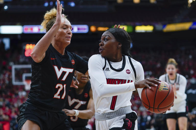 Louisville guard Dana Evans (1) drives toward the basket around Virginia Tech forward Lydia Rivers (21) during the first half of a women's NCAA college basketball game, Sunday, March 1, 2020, at the KFC YUM Center in Louisville, Ky. (AP Photo/Bryan Woolston)