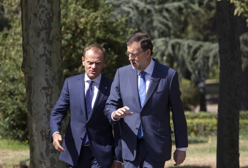Spain's Prime Minister Mariano Rajoy, right speaks with his Polish counterpart Donald Tusk as they walk in the gardens of the Moncloa Palace in Madrid, Spain Monday July 15, 2013. Conservative Spanish Prime Minister Mariano Rajoy is certain to face a barrage of questions in a press conference following newspaper publication of alleged text message exchanges between him and a now jailed former party treasurer that have prompted opposition demands for the premier to resign. El Mundo published Sunday what it said were friendly text messages between Rajoy and former Popular Party treasurer Luis Barcenas. Barcenas is at the heart of a probe into a slush-fund scheme that allegedly included payments to top party figures including Rajoy. He is to be quizzed by a judge in the case again Monday. Spaniards are currently coping with harsh austerity measures and tough economic reforms designed to reduce the country's debt. (AP Photo/Paul White)