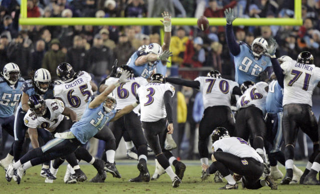 FILE - In this Jan 10, 2009, file photo, Baltimore Ravens' Matt Stover (3) kicks a 43-yard field goal with 53 seconds left in the fourth quarter to give the Ravens a 13-10 win over the Tennessee Titans in an NFL football divisional playoff game in Nashville, Tenn. Titans cornerback Cortland Finnegan (31) and defensive tackle Albert Haynesworth (92) try to block the kick. The Titans playing the Ravens in the divisional round Saturday night, Jan. 11, has revived strong memories of a very intense and bitter playoff rivalry along with the agony of possible Super Bowl titles lost. (AP Photo/Wade Payne, File)