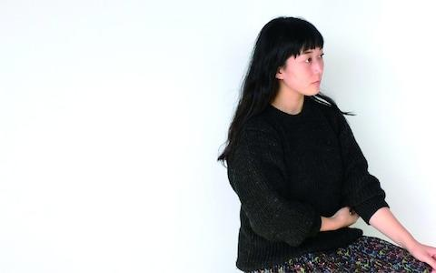 Eriko Yokoi created a system of interconnected holders in soft grey recycled fiber in which plants could grow
