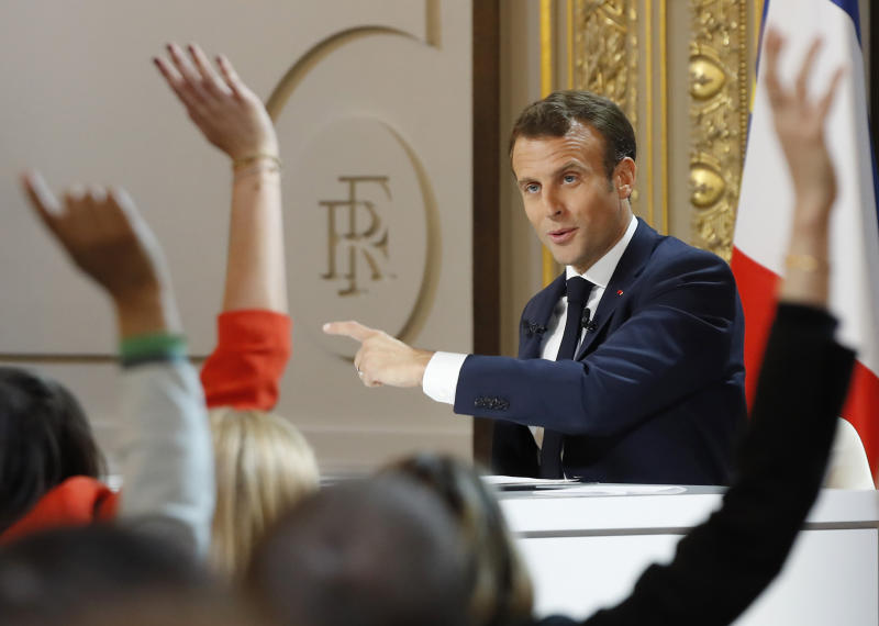 Members of the media raise their hands as French President Emmanuel Macron answering questions during a media conference at the Elysee Palace Thursday, April 25, 2019 in Paris. Macron makes a speech at the Elysee presidential palace based on three months of national debate aimed at addressing the protesters' concerns through town hall meetings and collecting complaints online. (AP Photo/Michel Euler)