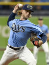 Tampa Bay Rays starter Shane Baz pitches against the Miami Marlins during the first inning of a baseball game Sunday, Sept. 26, 2021, in St. Petersburg, Fla. (AP Photo/Steve Nesius)