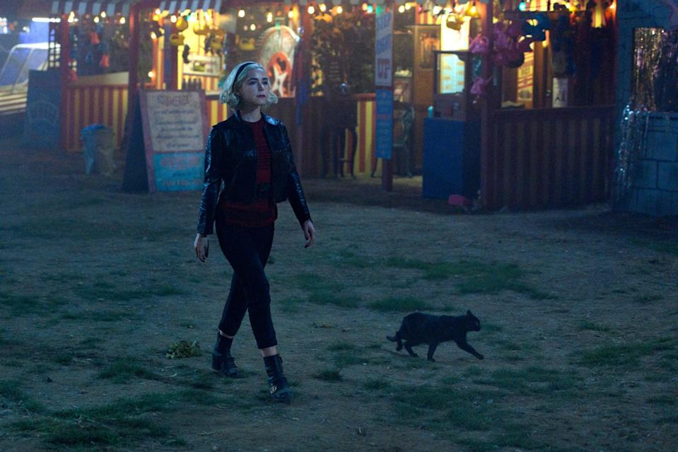 "<p>Half-mortal and half-witch, teenage Sabrina Spellman (Kiernan Shipka) has to choose between the human and dark magical world as she turns 16. If you grew up watching the <a href=""https://www.popsugar.com/entertainment/Original-Sabrina-Cast-Watches-Chilling-Adventures-Sabrina-45435652"" class=""link rapid-noclick-resp"" rel=""nofollow noopener"" target=""_blank"" data-ylk=""slk:Melissa Joan Hart"">Melissa Joan Hart</a> and animated versions, Netflix's adaptation has the same characters (including Sabrina's aunts and Harvey), but it's definitely a lot darker!</p> <p><a href=""http://www.netflix.com/title/80223989"" class=""link rapid-noclick-resp"" rel=""nofollow noopener"" target=""_blank"" data-ylk=""slk:Watch Chilling Adventures of Sabrina on Netflix."">Watch <strong>Chilling Adventures of Sabrina</strong> on Netflix.</a></p>"