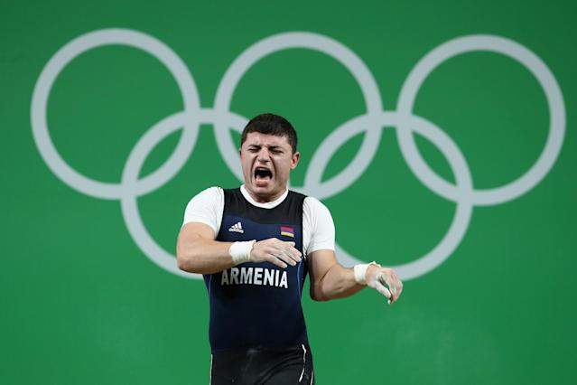 <p>Hyperextension gone wrong. Armenian weightlifter Andranik Karapetyan was in second place when he lifted the weights above his head. Shortly after his arm went backward, resulting in what appeared to be a dislocated elbow. OUCH! </p>