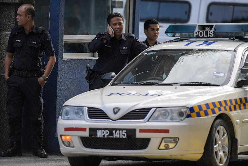 Malaysian police guard the main gate of the forensic wing at the Hospital Kuala Lumpur, where the body of Kim Jong-Nam, half-brother of North Korean leader Kim Jong-Un, is being kept (AFP Photo/MOHD RASFAN)