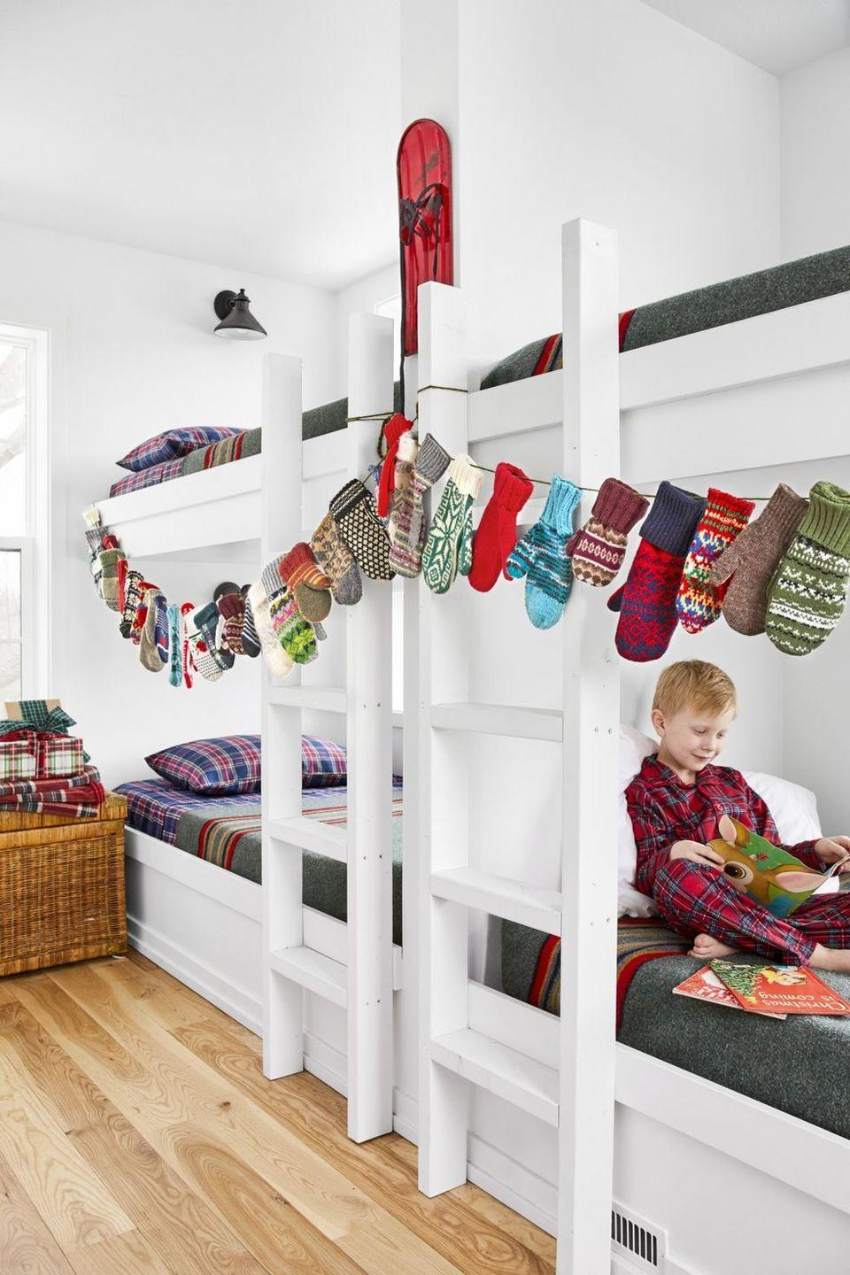 """<p>Clip an assortment of colorful mittens to a clothesline for something that's just as functional as it is eye-catching. Just make sure you keep it within reach, so that everyone can get a hold of their favorites.</p><p><strong>RELATED: </strong><a href=""""https://www.goodhousekeeping.com/holidays/christmas-ideas/g34004079/winter-crafts/"""" rel=""""nofollow noopener"""" target=""""_blank"""" data-ylk=""""slk:Winter Crafts That Anyone Can Make"""" class=""""link rapid-noclick-resp"""">Winter Crafts That Anyone Can Make </a></p>"""