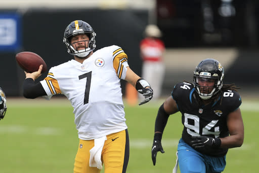 Pittsburgh Steelers quarterback Ben Roethlisberger (7) throws a pass as he gets around Jacksonville Jaguars defensive end Dawuane Smoot (94) during the first half of an NFL football game, Sunday, Nov. 22, 2020, in Jacksonville, Fla. (AP Photo/Matt Stamey)