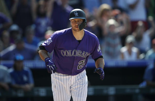 Colorado Rockies' Chris Iannetta heads to first base after drawing a walk off Los Angeles Dodgers relief pitcher Dylan Floro with the bases loaded to force in the winning run in the ninth inning of a baseball game Sunday, Aug. 12, 2018, in Denver. Colorado won 4-3. (AP Photo/David Zalubowski)
