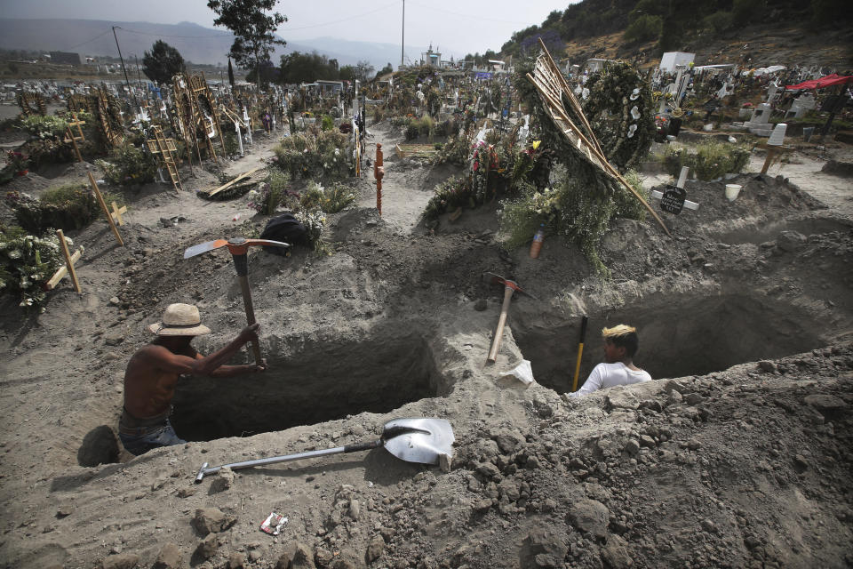 FILE - In this March 31, 2021 file photo, men dig graves at the Valle de Chalco cemetery during the new coronavirus pandemic on the outskirts of Mexico City. Mexico's unwillingness to spend money, do more testing, change course or react to new scientific evidence contributed to the country being one of the worst-hit by the coronavirus pandemic, according to a report released the third week of April, by the University of California, San Francisco. (AP Photo/Marco Ugarte, File)
