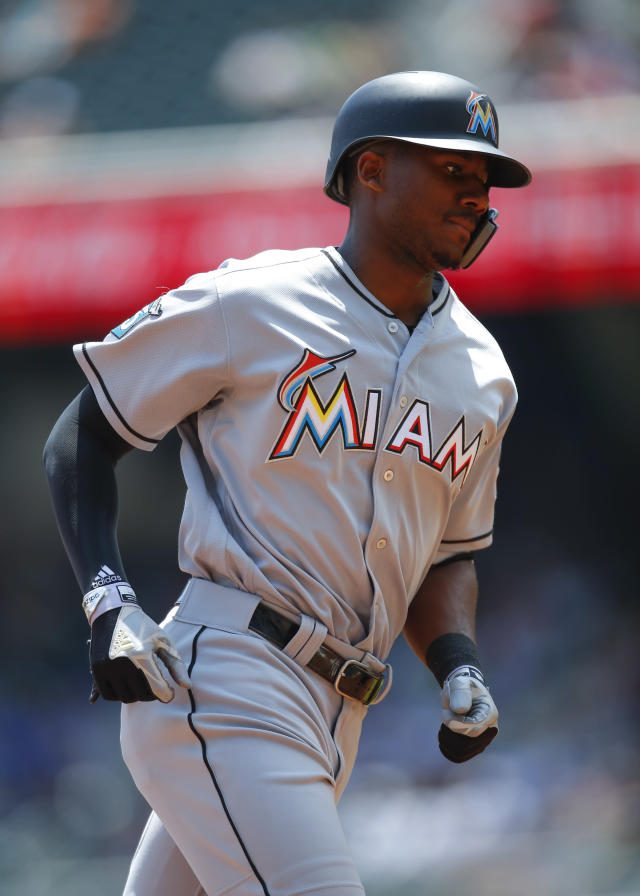 Miami Marlins Lewis Brinson rounds third base after hitting a grand slam in the fourth inning of a baseball game against the Atlanta Braves, Sunday, May 20, 2018, in Atlanta. (AP Photo/Todd Kirkland)