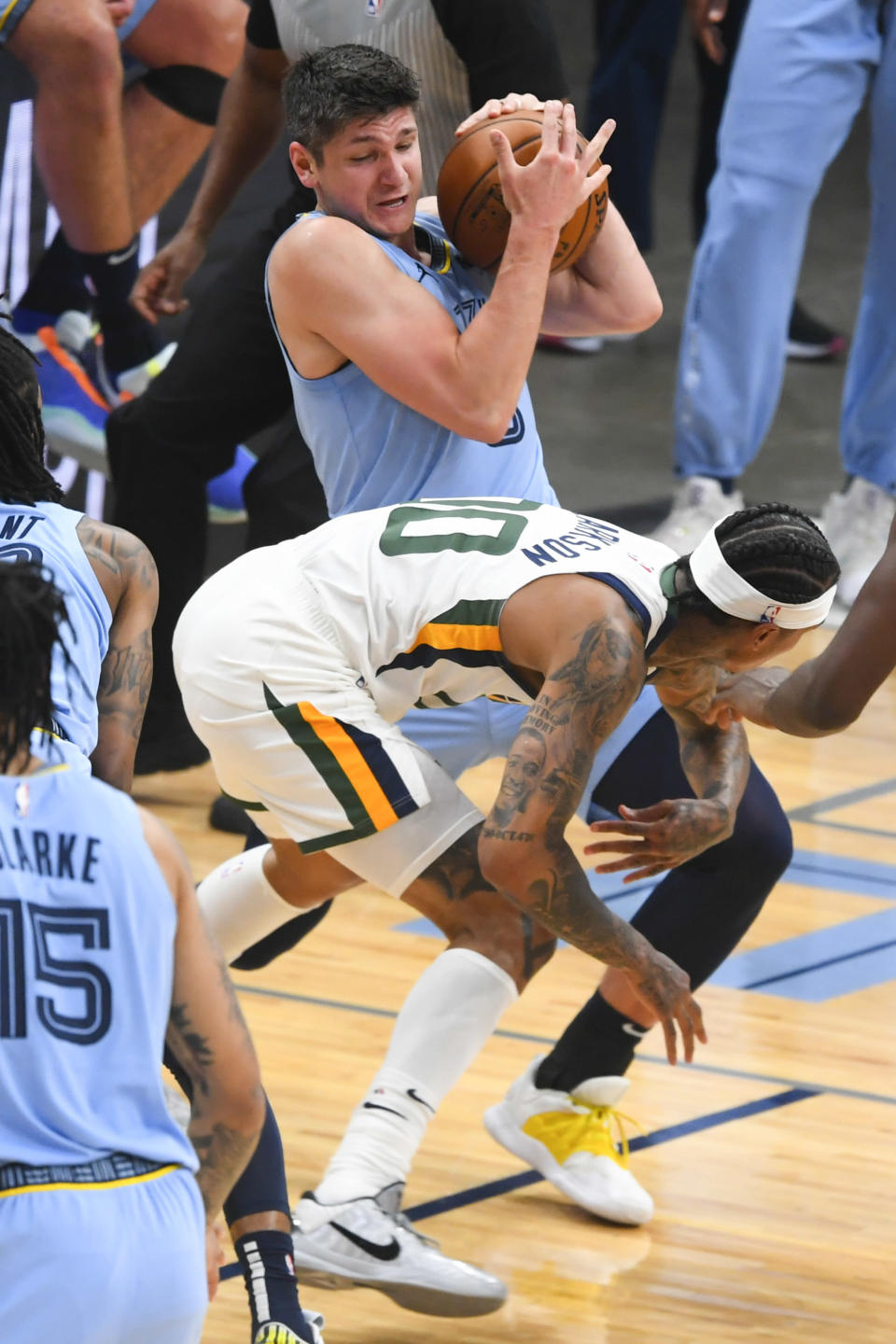 Memphis Grizzlies guard Grayson Allen tries to keep the ball from Utah Jazz guard Jordan Clarkson during the first half of Game 3 of an NBA basketball first-round playoff series Saturday, May 29, 2021, in Memphis, Tenn. (AP Photo/John Amis)