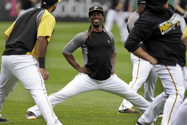 Pittsburgh Pirates' Andrew McCutchen, center, talks with teammate Pedro Alvarez, left, while they stretch during the baseball team's workout in Pittsburgh Monday, Sept. 30, 2013. The Pirates face the Cincinnati Reds in the National League Wild Card game Tuesday in Pittsburgh. (AP Photo/Gene J. Puskar)