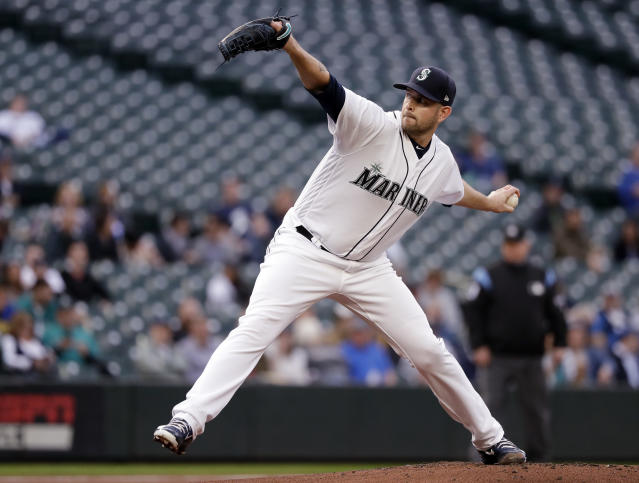Seattle Mariners starting pitcher James Paxton throws to an Oakland Athletics batter during the first inning of a baseball game Wednesday, May 2, 2018, in Seattle. (AP Photo/Elaine Thompson)