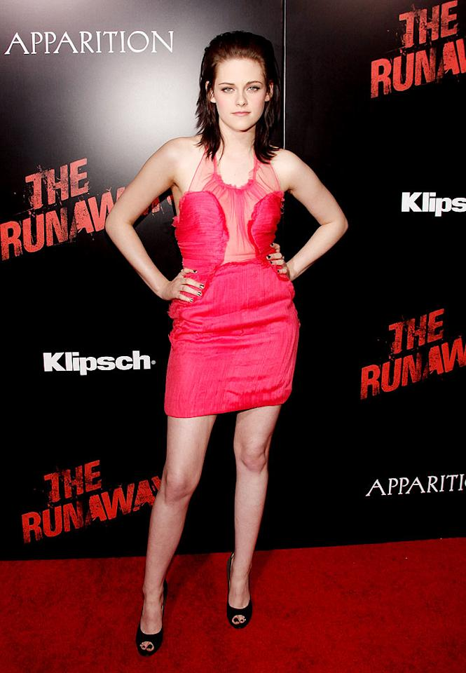 "Following in Ms. Fanning's footsteps was her ""Runaways"" and ""New Moon"" co-star Kristen Stewart, who popped a pose in a fab bubblegum-pink Doo.Ri frock and fierce peep-toes. Todd Williamson/<a href=""http://www.wireimage.com"" target=""new"">WireImage.com</a> - March 11, 2010"
