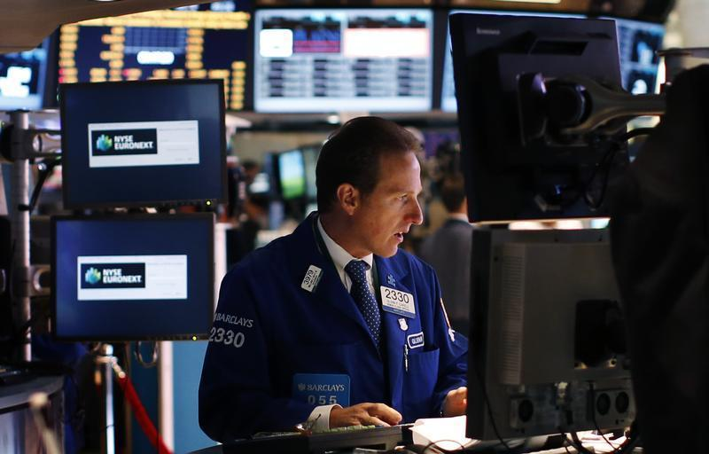 A trader works on the main trading floor of the New York Stock Exchange shortly after the opening bell in New York