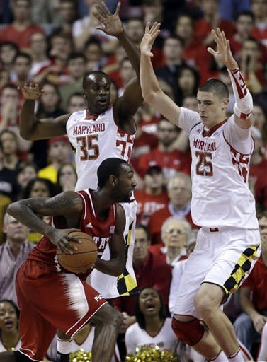 Maryland forward James Padgett (35) and center Alex Len, of Ukraine, guard North Carolina State forward C.J. Leslie as he tries to drive to the basket in the second half of an NCAA college basketball game in College Park, Md., Wednesday, Jan. 16, 2013. Maryland won 51-50. (AP Photo/Patrick Semansky)