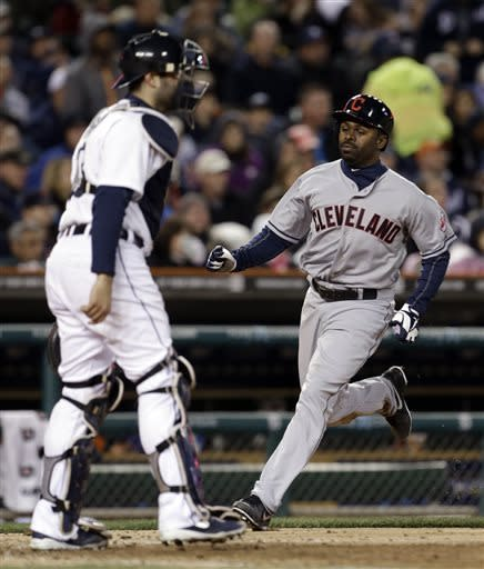 Cleveland Indians' Michael Bourn, right, scores past Detroit Tigers catcher Alex Avila on an Asdrubal Cabrera single in the sixth inning of a baseball game in Detroit, Saturday, May 11, 2013. (AP Photo/Paul Sancya)