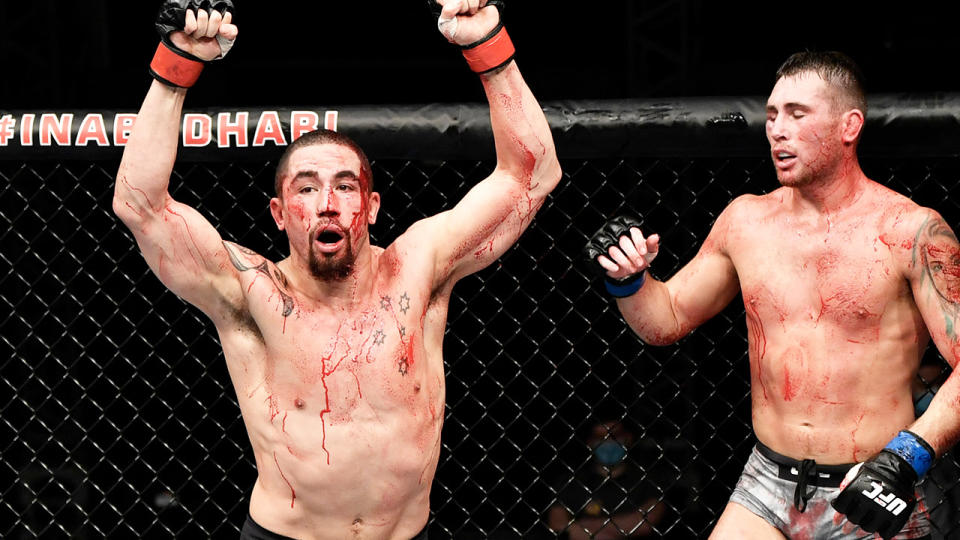 Robert Whittaker celebrates after the fight against and Darren Till.