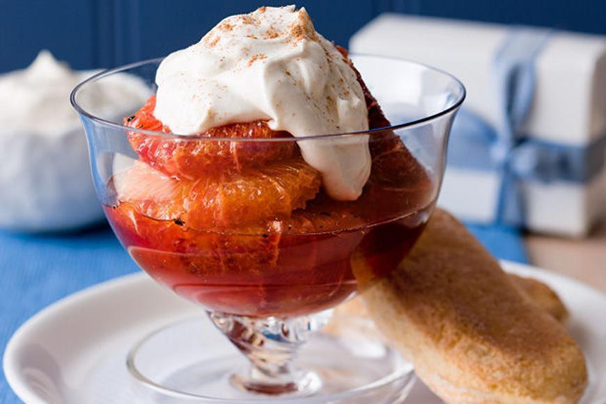 """This sophisticated-looking dessert of <a rel=""""nofollow"""" href=""""https://au.lifestyle.yahoo.com/food/recipes/r/8027771/whisky-blood-oranges-with-cinnamon-cream-recipe/"""">whisky infused blood oranges with cinnamon cream</a> is surprisingly simple to create and is simply delicious."""