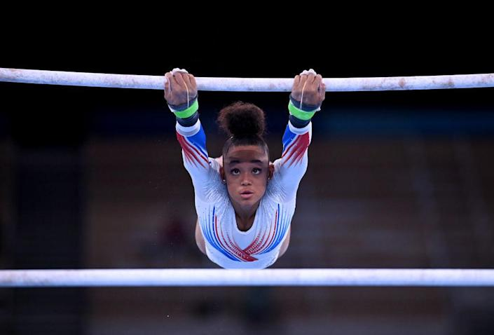 """France's Melanie de Jesus dos Santos competes on the uneven bars during the women's gymnastics team event final at the Summer Olympics in Tokyo, Japan on July 27, 2021.<span class=""""copyright"""">Marijan Murat—picture alliance via Getty Images</span>"""