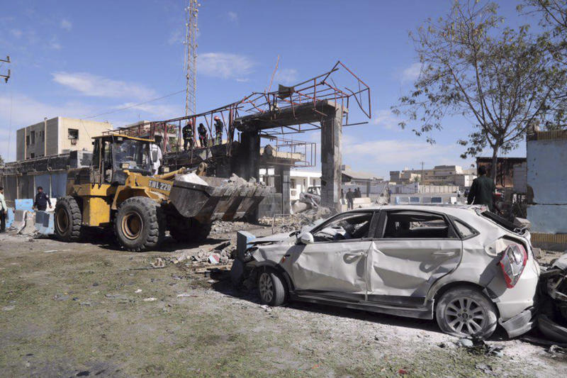 In this photo released by Tasnim News Agency, the wreckage of a car is seen after a suicide car bombing at the gate of a police headquarters in the southeastern Iranian port city of Chabahar, Thursday, Dec. 6, 2018. Rahmdel Bameri, a provincial official, told state TV that a suicide attacker driving a vehicle loaded with explosives drove up to the police headquarters. He said police officers blocked the vehicle and started firing at the driver, who then detonated his explosives. (Tasnim News Agency via AP)