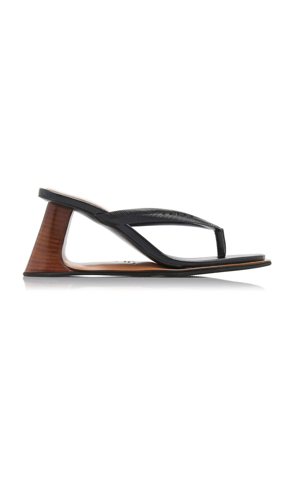 """<p><strong>Marni</strong></p><p>modaoperandi.com</p><p><strong>$890.00</strong></p><p><a href=""""https://go.redirectingat.com?id=74968X1596630&url=https%3A%2F%2Fwww.modaoperandi.com%2Fmarni-ss20%2Freverse-leather-thong-sandals&sref=https%3A%2F%2Fwww.harpersbazaar.com%2Ffashion%2Ftrends%2Fg31749966%2Fsummer-2020-shoe-trends%2F"""" rel=""""nofollow noopener"""" target=""""_blank"""" data-ylk=""""slk:Shop Now"""" class=""""link rapid-noclick-resp"""">Shop Now</a></p><p>Is it a heel? Is it a wedge? We'll let you decide.</p>"""