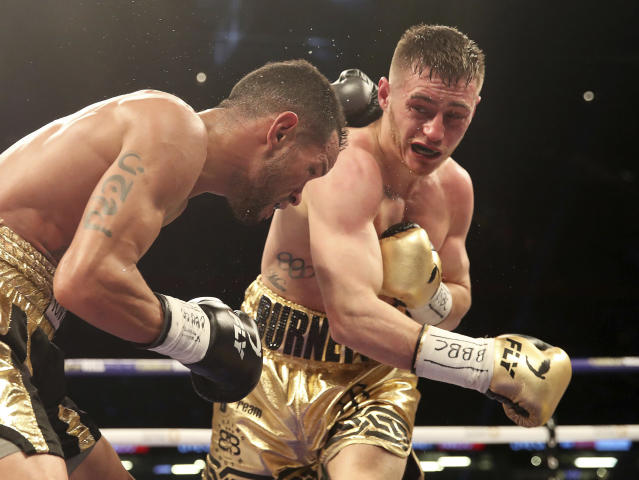 Ryan Burnett (R), shown here in action against Yonfrez Parejo on March 31, 2018, has agreed to take part in Season 2 of the World Boxing Super Series. (AP)