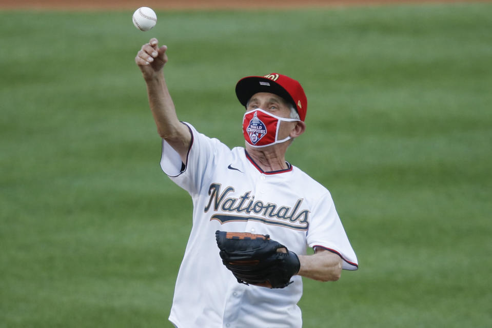 Ceremonial first pitch is thrown by Dr. Anthony Fauci, Director of the National Institute of Allergy and Infectious Diseases before the start of the during the first inning of an opening day baseball game between the New York Yankees and Washington Nationals at Nationals Park, Thursday, July 23, 2020, in Washington. (AP Photo/Alex Brandon)