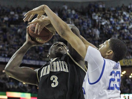 Kentucky forward Anthony Davis (23) blocks the shot of Vanderbilt center Festus Ezeli (3) during the first half of an NCAA college basketball game in the championship game of the Southeastern Conference tournament at the New Orleans Arena in New Orleans, Sunday, March 11, 2012. (AP Photo/Gerald Herbert)