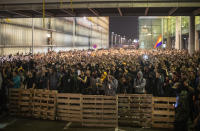 Protestors make a barricade during clashes with police outside El Prat airport in Barcelona, Spain, Monday, Oct. 14, 2019. Riot police have charged at protesters outside Barcelona's airport after the Supreme Court sentenced 12 prominent Catalan separatists to lengthy prison terms for their roles in a 2017 push for the wealthy Spanish region's independence. (AP Photo/Emilio Morenatti)