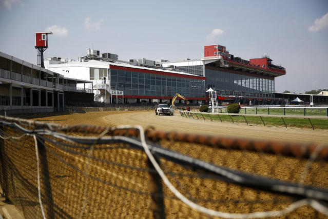 FILE - In this May 15, 2018, file photo, preparations take place for the Preakness Stakes horse race at Pimlico Race Course in Baltimore. The future of Pimlico has turned into a tug of war involving city officials, who want it to stay in Baltimore, and the owners of the track, who long to move the second jewel of the Triple Crown to nearby Laurel. (AP Photo/Patrick Semansky, File)