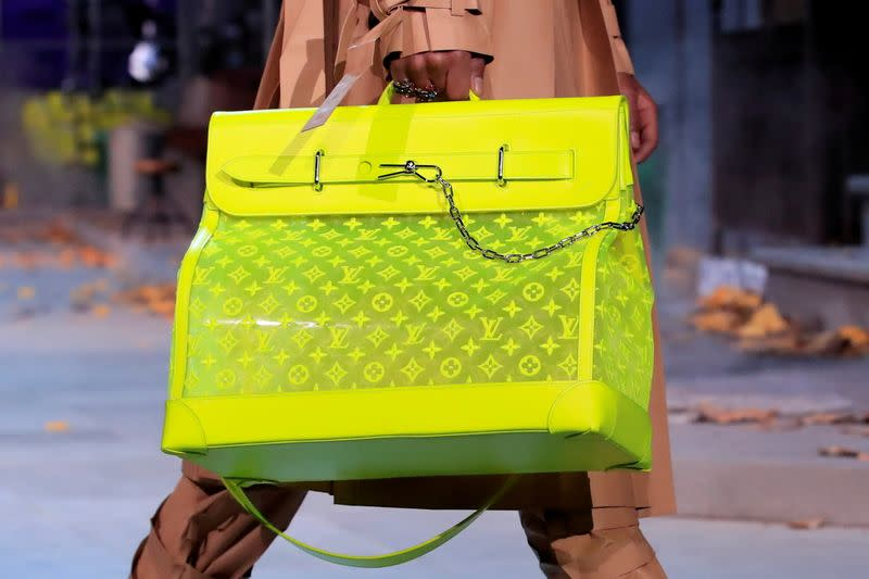 FILE PHOTO: FILE PHOTO: A model presents a bag creation by designer Virgil Abloh during a preview show for his Fall/Winter 2019-2020 collection for fashion house Louis Vuitton during Men's Fashion Week in Paris