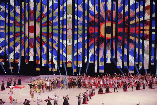 Indonesia's team marches during the opening ceremony of the 30th South East Asian Games at the Philippine Arena, Bulacan province, northern Philippines on Saturday, Nov. 30, 2019. (AP Photo/Aaron Favila)