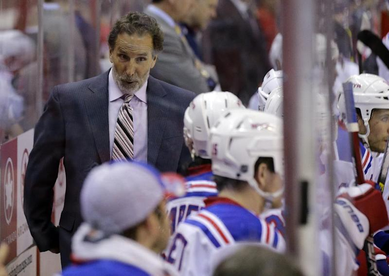 FILE - In this May 10, 2013 file photo, New York Rangers head coach John Tortorella talks with his team in the second period of Game 5 in the first-round NHL Stanley Cup playoff hockey series against the Washington Capitals, in Washington. The Rangers have fired coach Tortorella, Wednesday, May 29, 2013, four days after New York was eliminated from the Stanley Cup playoffs.(AP Photo/Alex Brandon)