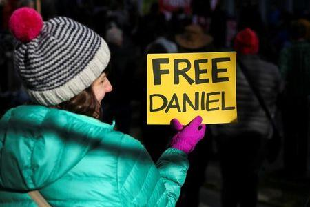 A woman holds a sign outside of the U.S. District Court during a rally in support of Daniel Ramirez Medina, who was detained by U.S. immigration authorities, in Seattle, Washington