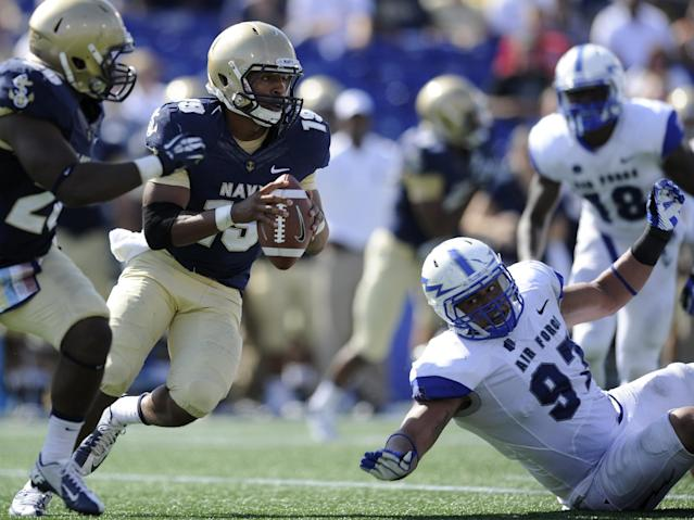 Navy quarterback Keenan Reynolds (19) scrambles past Air Force defensive lineman Nick Fitzgerald (97) during the second half of an NCAA football game, Saturday, Oct. 5, 2013, in Annapolis, Md. Navy won 28-10. (AP Photo/Nick Wass)