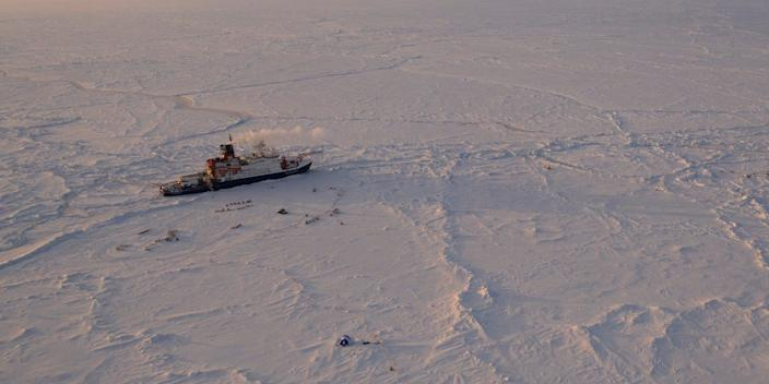 In this Friday, April 24, 2020 photo provide by the Alfred Wegener Insitute shows the German Arctic research vessel Polarstern in the ice next to a research camp in the Arctic region. Germany's Alfred Wegener Institute for Polar and Ocean Research says the expedition ship RV Polarstern will leave its position in the high Arctic for three weeks to rendezvous with two vessels bringing fresh supplies and crew. (Manuel Ernst/Alfred-Wegner-Institut via AP)