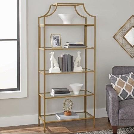 <p>For a more glam interior decor, the <span>Bookcase With Gold Finish Open Shelving</span> ($340) will match the rest of your lush furniture.</p>