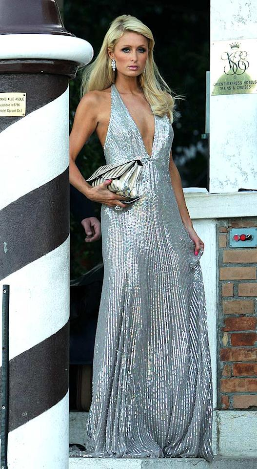 """But Eva wasn't the only looker in Italy. Socialite Paris Hilton cleaned up her act and delivered a """"wow"""" moment in a sequined Jenny Packham masterpiece and side-swept 'do. Dan Kitwood/<a href=""""http://www.gettyimages.com/"""" target=""""new"""">GettyImages.com</a> - September 4, 2009"""