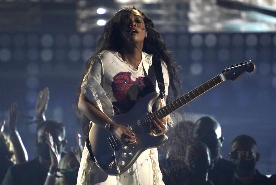 """FILE - H.E.R. performs at the BET Awards on June 27, 2021, in Los Angeles. In addition to making great music, the Grammy and Oscar-winning recording artist wants to be an active citizen that empowers young people with information. She gets to do both in the new animated Netflix series, """"We the People."""" (AP Photo/Chris Pizzello, File)"""