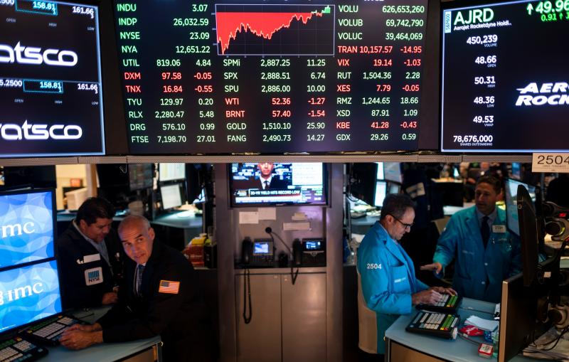Traders work after the closing bell at the New York Stock Exchange (NYSE) on August 7, 2019 in New York City. - Wall Street stocks finished little changed on August 7, 2019, following a choppy session as a plunge in treasury bond yields early in the day underscored worries about a weakening global economy. (Photo by Johannes EISELE / AFP) (Photo credit should read JOHANNES EISELE/AFP/Getty Images)