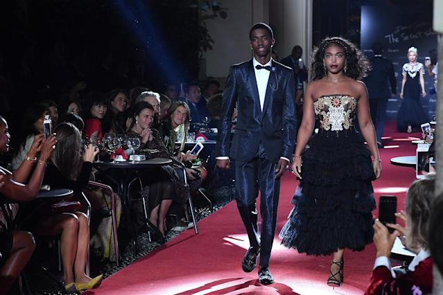 Christian Combs and Lori Harvey walk the runway at the Dolce & Gabbana secret show during Milan Fashion Week Spring/Summer 2018 at Bar Martini on Sept. 23, in Milan, Italy. (Jacopo Raule via Getty Images)